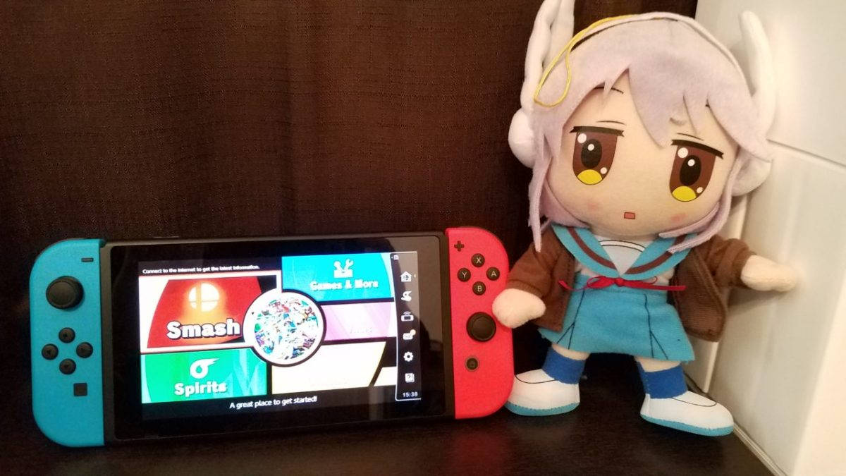 Headphones Nagato posing with a Nintendo Switch.